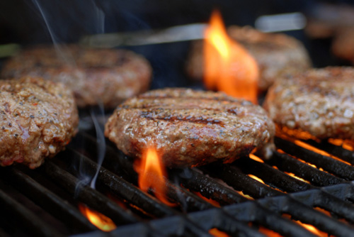 Grilling Hamburgers During Mardi Gras
